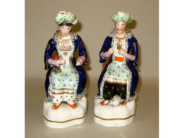 A pair of Staffordshire figures of Turks,