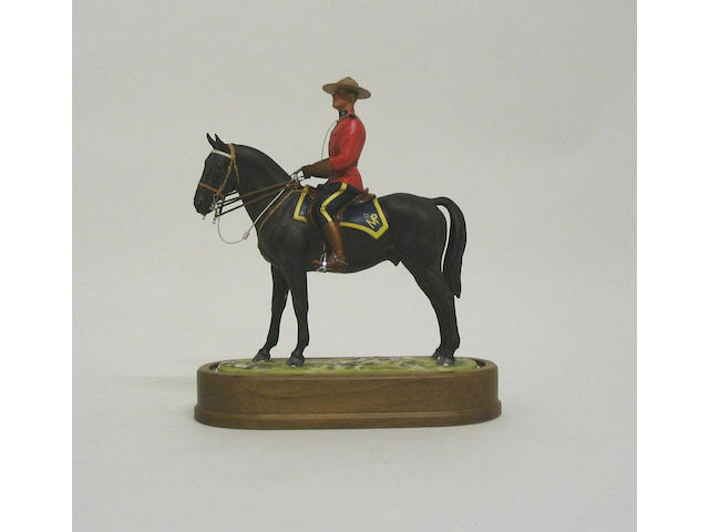 A Royal Worcester limited edition model of a Royal Canadian Mounted Policeman,