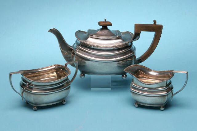A three piece tea service, by George Fowkes Lowe, Chester 1938,