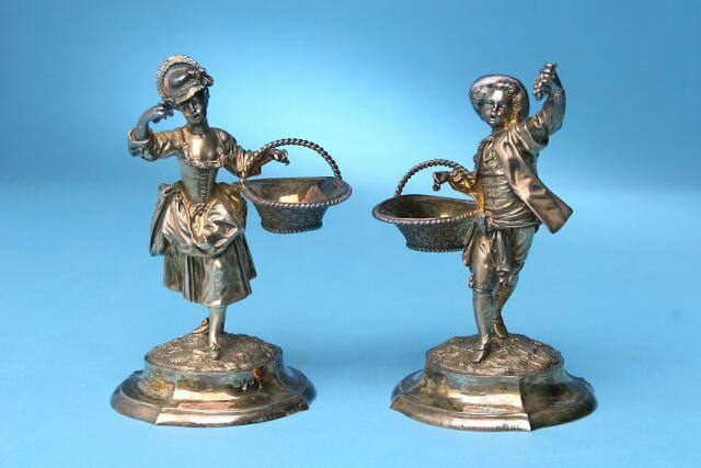 A pair of Victorian figural salts, by Alfred Benson and Henry Hugh Webb, London 1895, inscribed Hunt and Roskill, late Storr and Mortimer, numbered 1401,