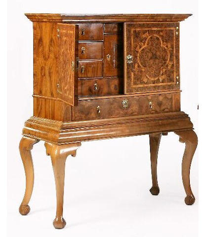A William and Mary laburnum oyster veneered cabinet on stand,