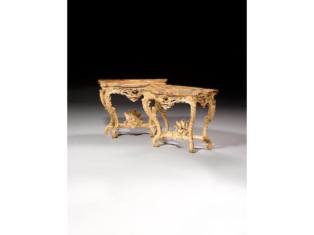 A pair of George III carved giltwood serpentine Console Tables,in the manner of Matthias Lock,