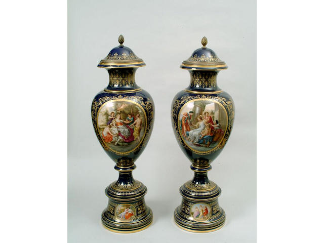 A large pair of Vienna style vases and covers