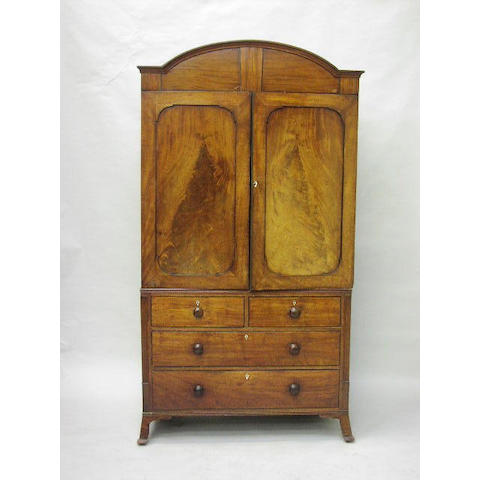 A Regency mahogany and ebony strung linen press,