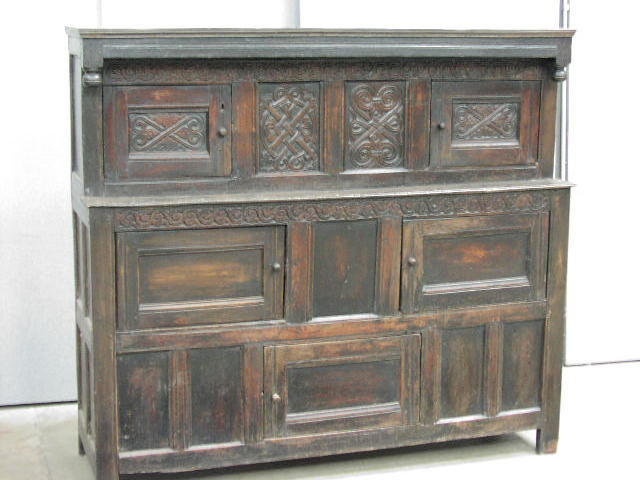 A late 17th Century carved oak court cupboard,