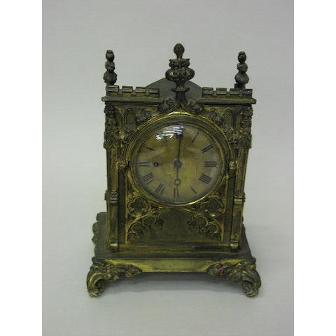 A 19th Century gothic revival gilt brass bracket time piece,