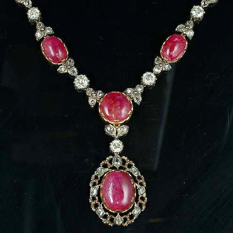 A ruby and diamond necklace and pair of earclips by Mario Buccellati
