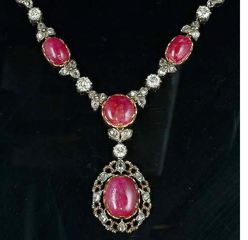 A ruby and diamond necklace and pair of earclips, by Mario Buccellati,