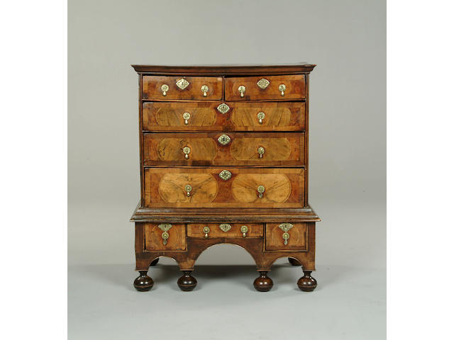A William and Mary burr yew and walnut chest on stand