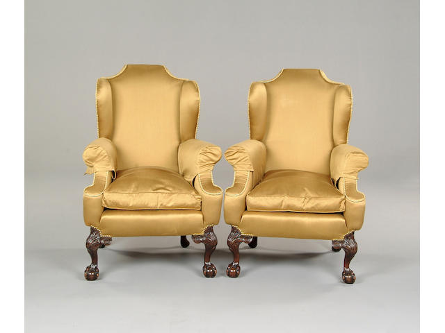 A pair of George III style upholstered armchairs