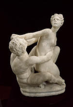 A white marble sculpture of a nymph struggling with a satyr