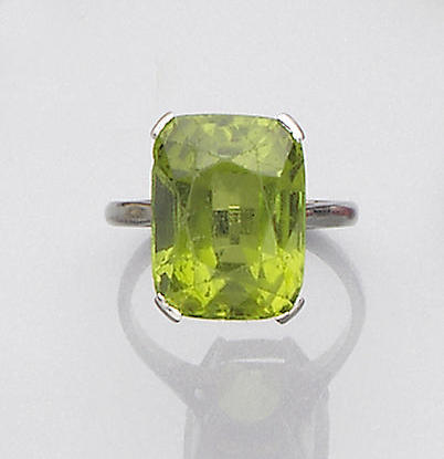 An early 20th century peridot and diamond brooch and a peridot ring (2)