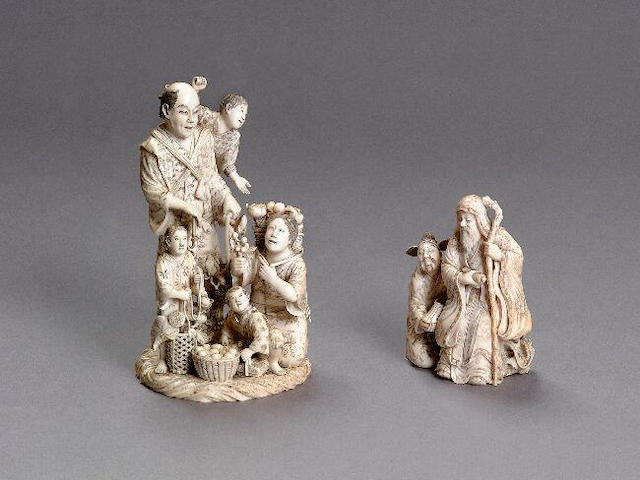 A fine well carved and decorated figural group, of a farmer and family gathering fruit, signed Naga (?), 18cm high.