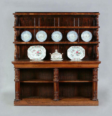 A William IV/early Victorian rosewood tiered open dresser/bookcase in two parts, the upper shelves w