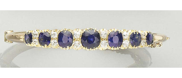 A sapphire and diamond hinged bangle,