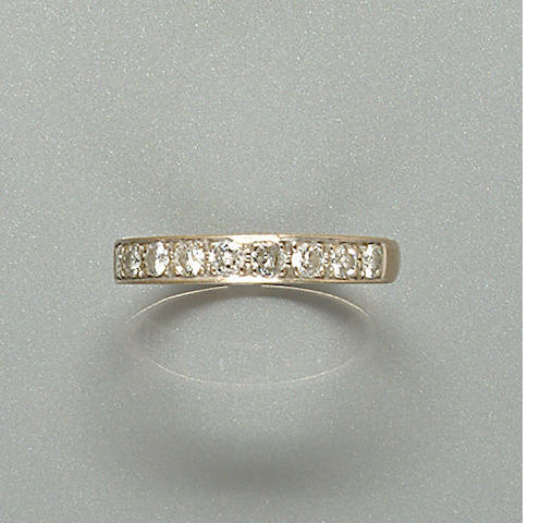 A diamond half-hoop eternity ring,