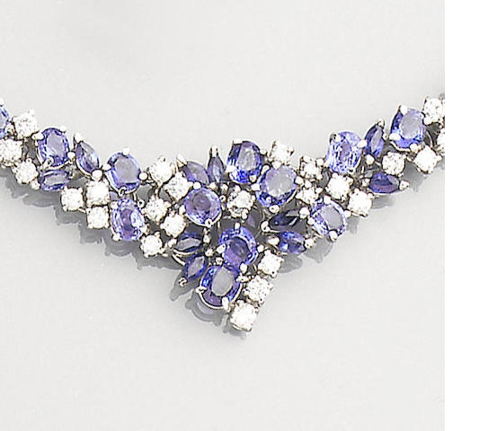 A sapphire and diamond necklace, bracelet, earclip and ring suite,