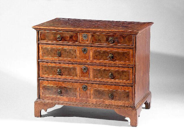 A late 17th/early 18th Century chest, of two short and three long graduated drawers, the top and front oyster veneered and crossbanded in elm, 97cm wide (restored and partly re-veneered).
