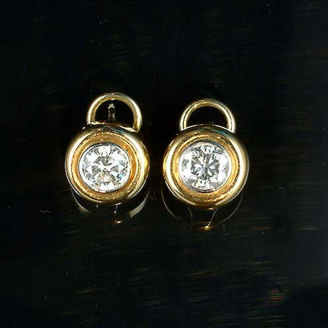 A pair of diamond earstuds, by Boodle and Dunthorne,