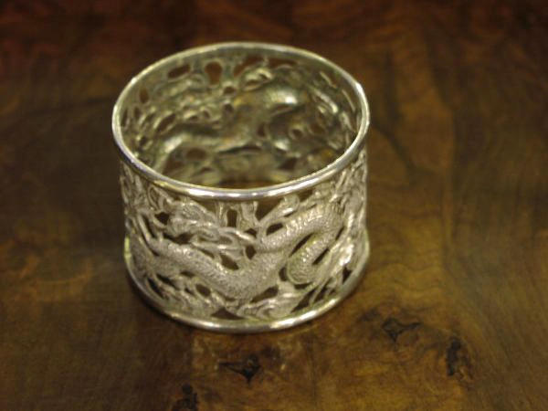 A set of four Chinese napkin rings, (4)
