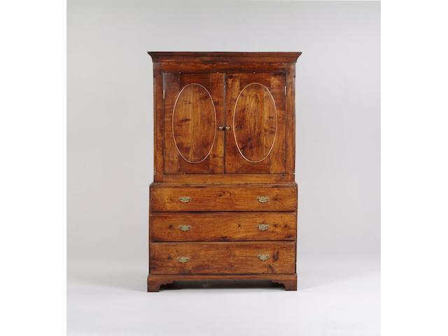 An early 19th Century oak livery cupboard,