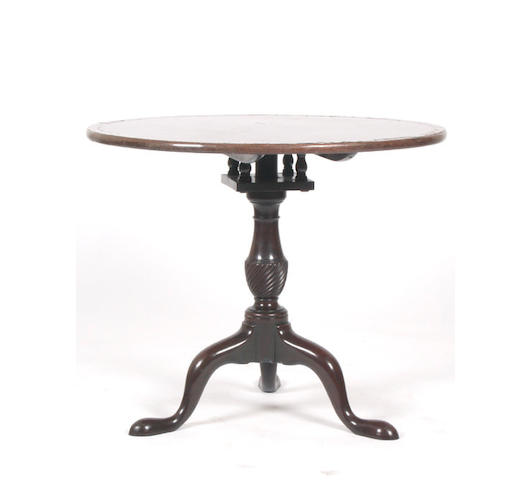 A George III mahogany snap top table