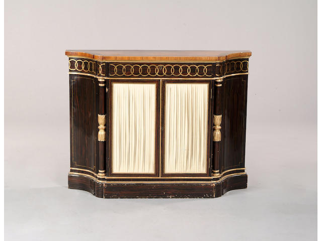 A Regency satinwood, faux rosewood and parcel gilt side cabinet