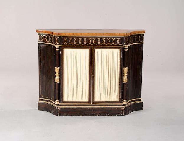 A Regency satinwood, faux rosewood and parcel gilt side cabinet