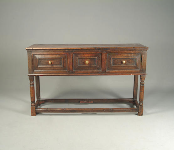 An early 18th century oak dresser base