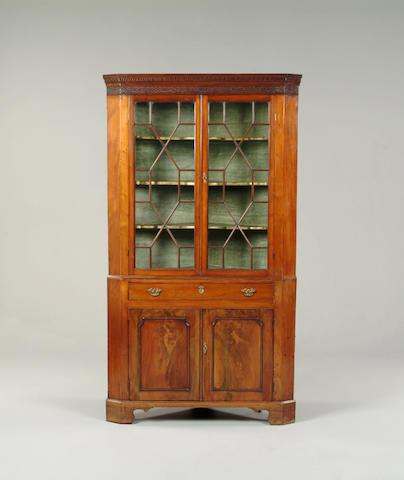 A George III mahogany corner cabinet