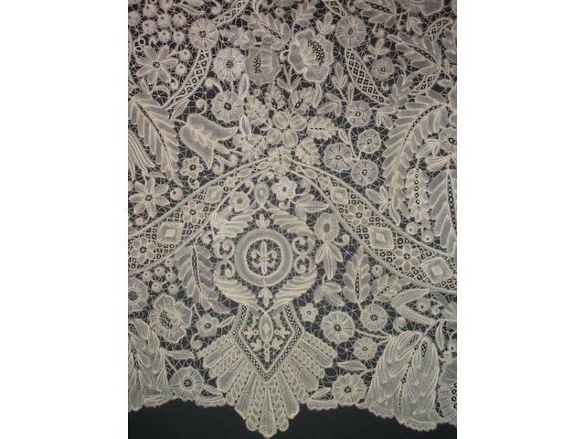 A deep flounce of fine Duchesse lace in a bold design,