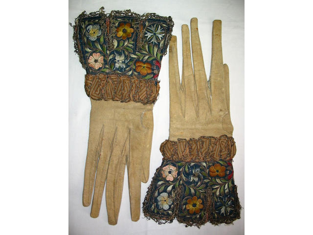 A late 16th/early 17th Century pair of square tabbed gauntlets,