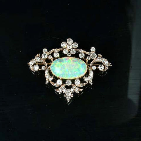 An early 20th century opal and diamond brooch/pendant,