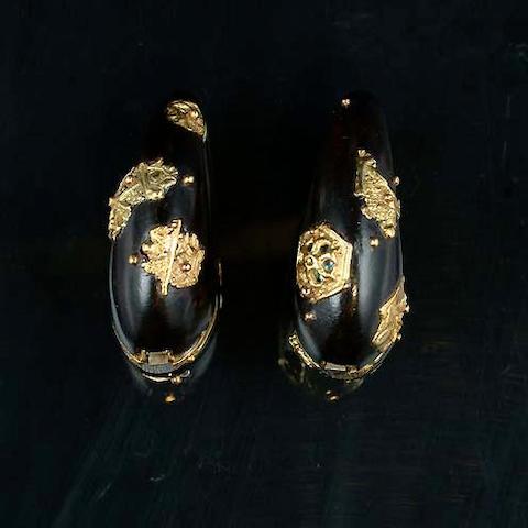 A pair of ebony earrings by Charles de Temple