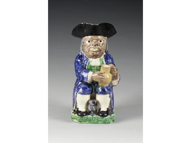 A creamware 'Collier' Toby jug, circa 1790,