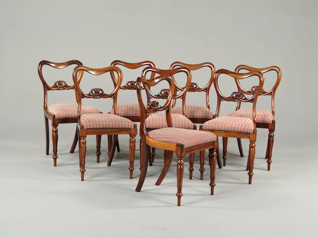 A set of eight Victorian rosewood balloon back chairs