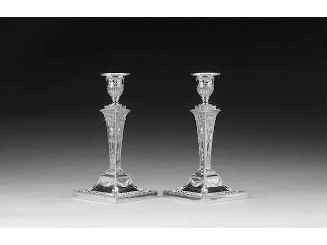 A pair of late Victorian silver candlesticks, by William Gibson & John Langman, London 1896,