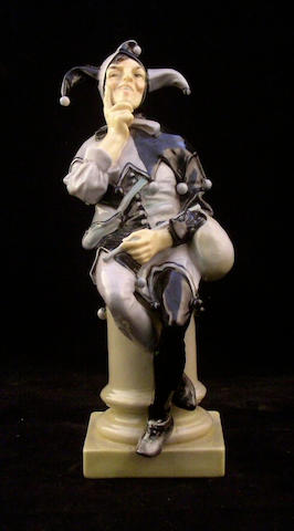 Figurines A Royal Doulton figure A Jester,