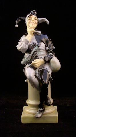 Figurines A Royal Doulton figure A Jester,