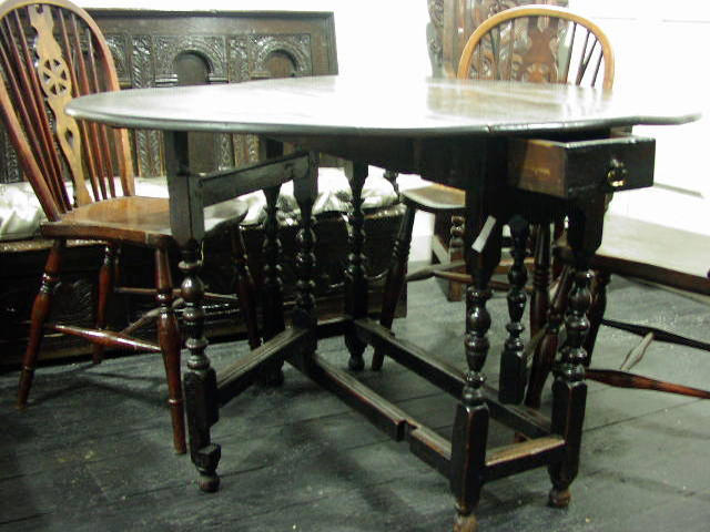 A late 17th Century oak gateleg dining table,