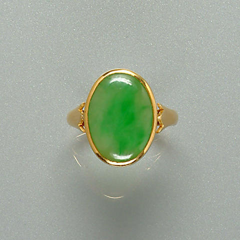 A jade single-stone ring, mounted by Asprey,