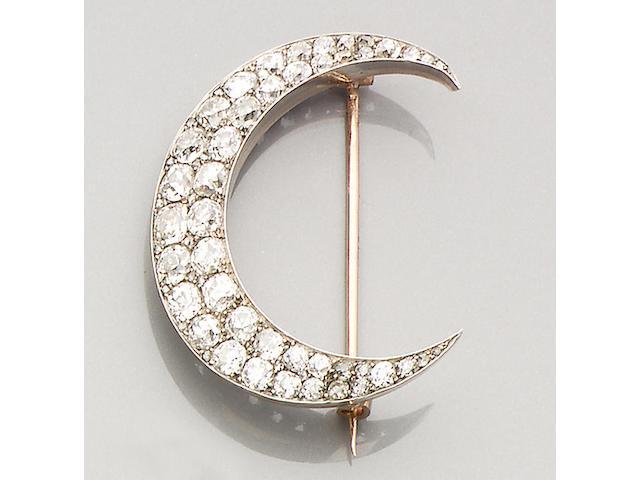 A diamond-set crescent brooch