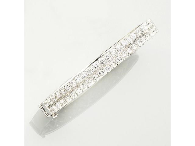 A diamond-set hinged bangle