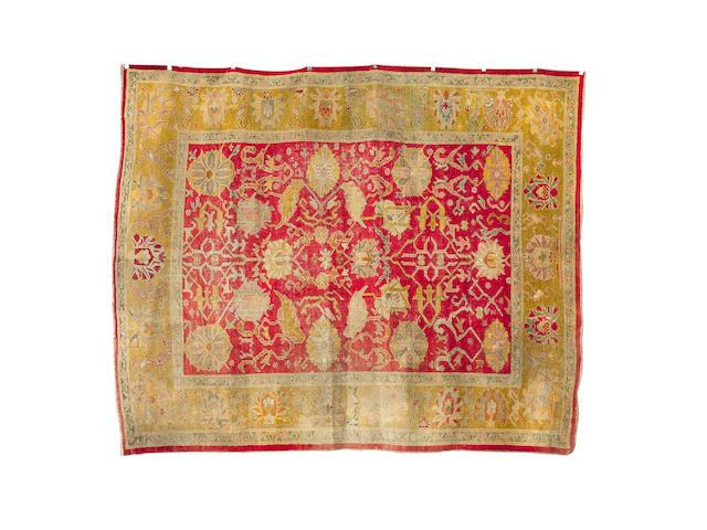 An Ushak carpet West Anatolia, 12 ft 10 in x 10 ft 6 in (391 x 320 cm)