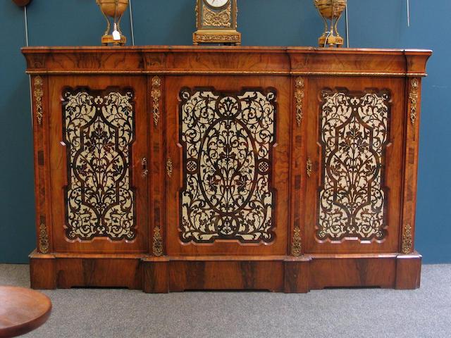 A Victorian walnut & gilt metal mounted breakfront Side Cabinet,