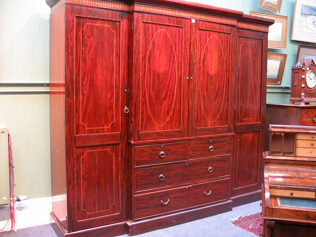 An Edwardian mahogany and inlaid breakfront Wardrobe,