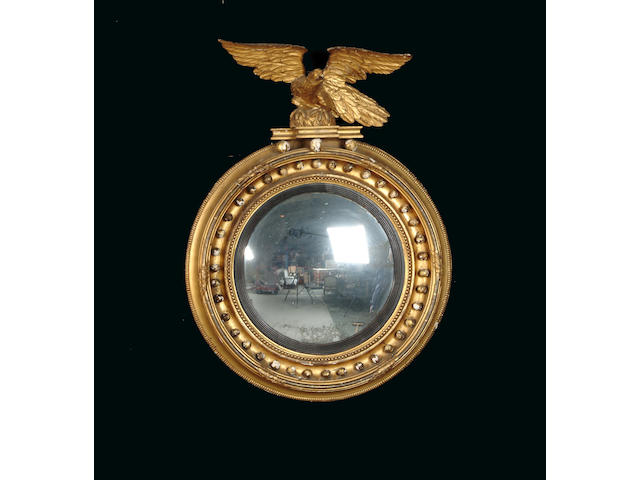 A Regency gilt carved and composition convex mirror