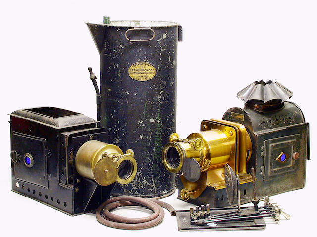 Magic Lanterns, two lanterns, brass and steel construction and associated items.