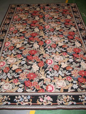 A Needlework rug 260cm x 169cm
