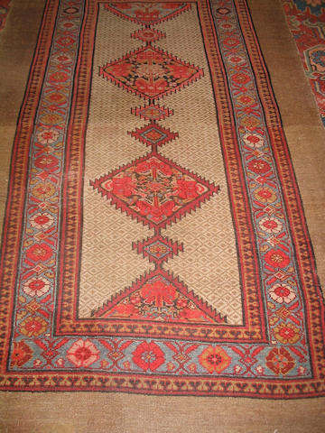 A Sarab rug North West Persia, 215cm x 129cm reduced in size